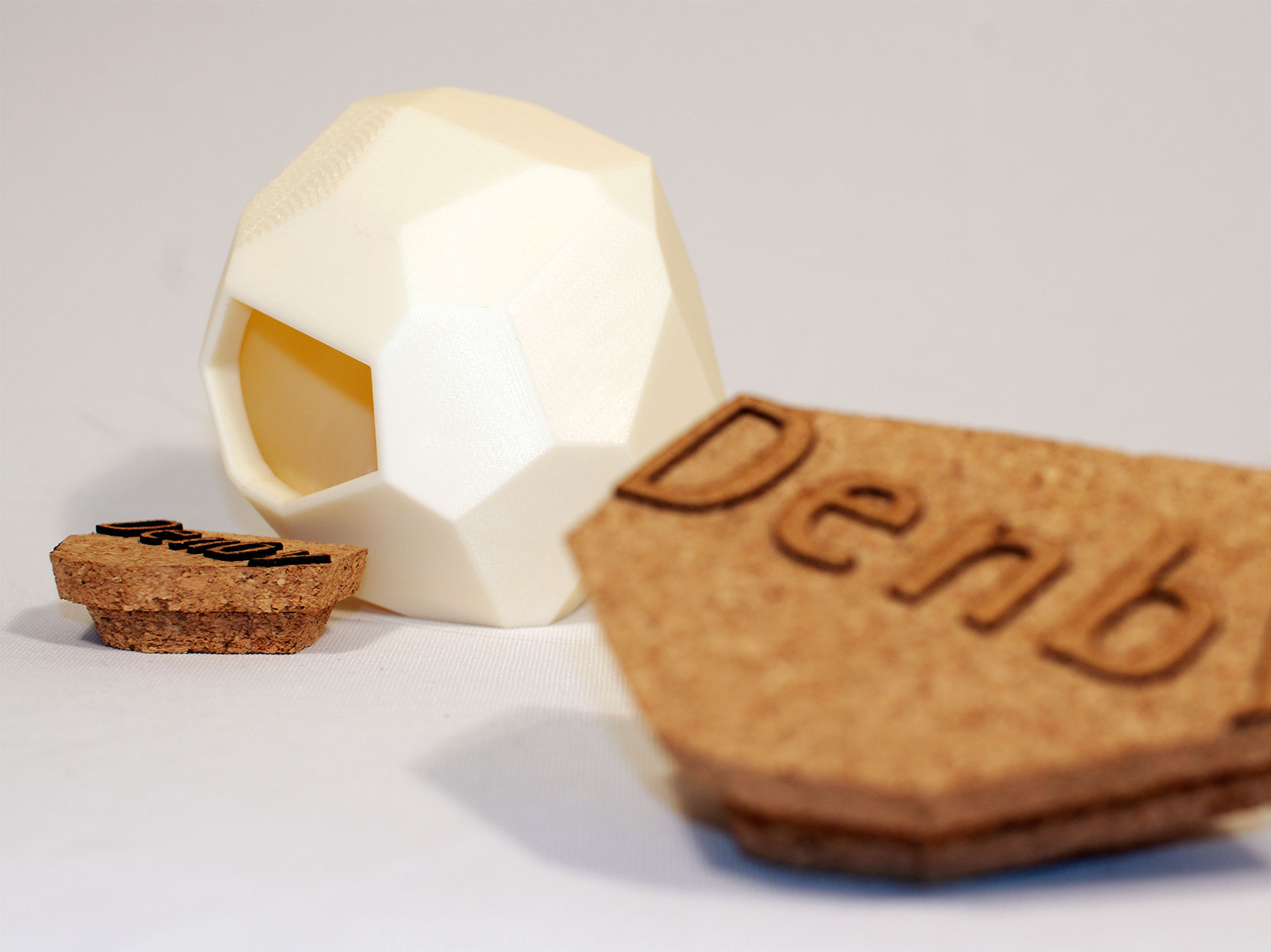 Denby Pottery biscuit barrel concept with faceted ceramic walls and thick cork lid